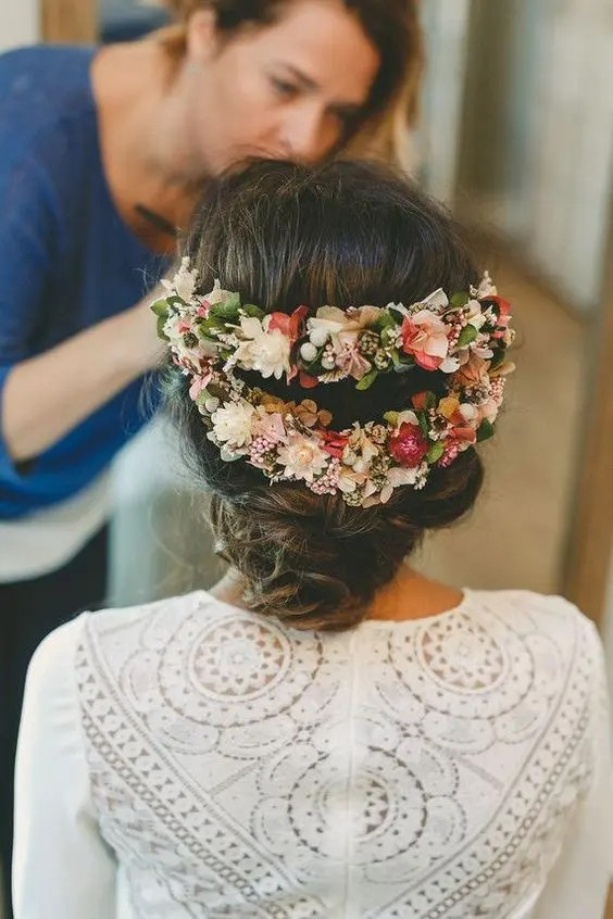 a cool fresh flower hairpiece of two parts highlights the romantic low updo