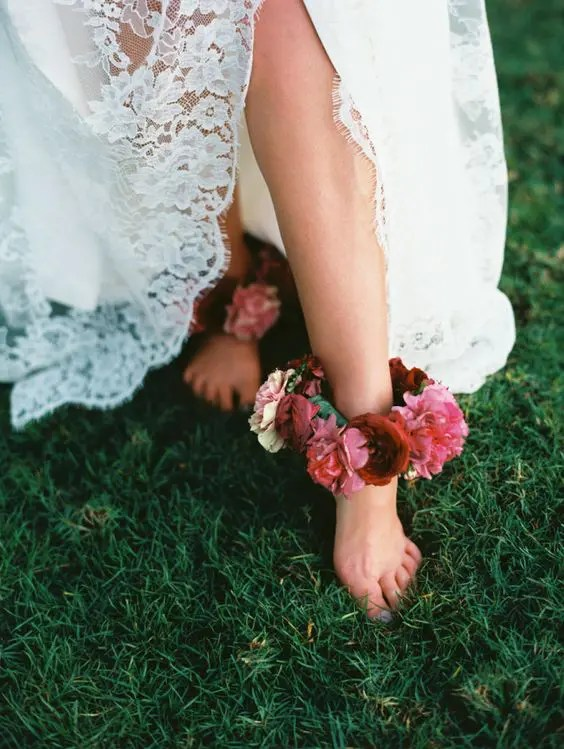 a lush and bold floral anklet in burgundy, pink and blush for a boho garden bride