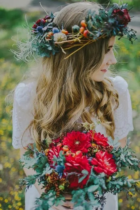 a colorful textural boho crown with thistles, berries, greenery and herbs for a fall boho bride