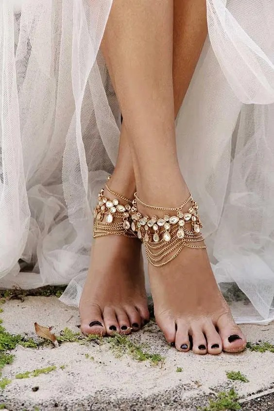 boho bridal anklets of multiple layer chains and rhinestones for a boho feel at the wedding