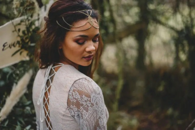 a gold boho chain headpeice with a pendant for a forest boho bride