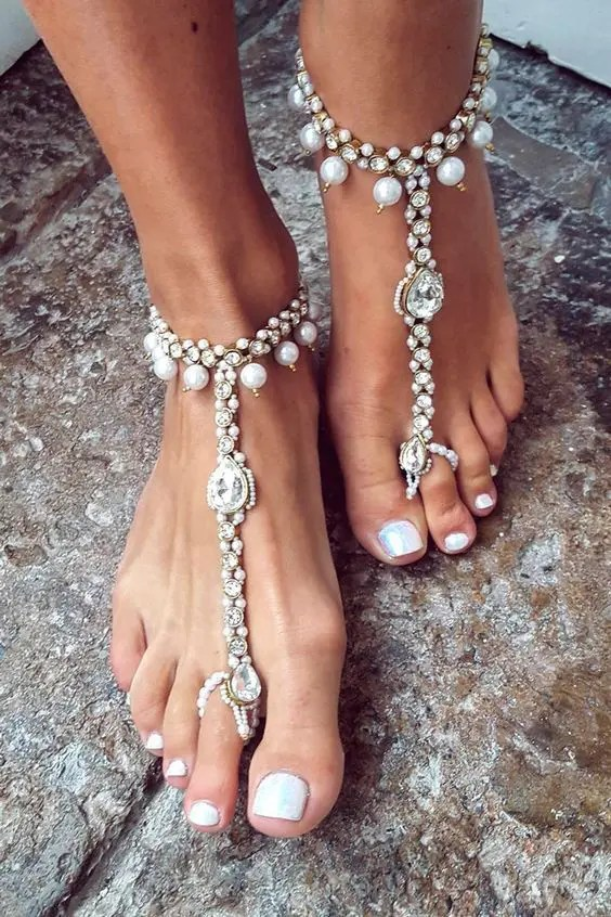 bold gypsy-inspired barefoot sandals with rhinestones and pearls for a coastal boho bride
