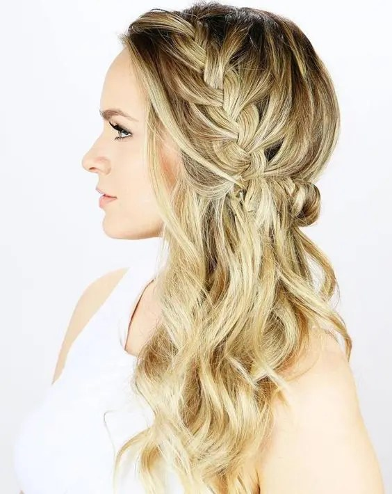 a side braided half updo with waves is a trendy idea with a twist to a usual braid