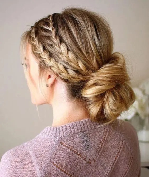 a double braided halo with a low twisted chignon guarantees a picture-perfect look for the whole day