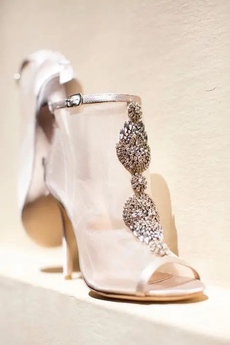 sheer peep toe wedding booties with large embellishments for a fashion-forward bride