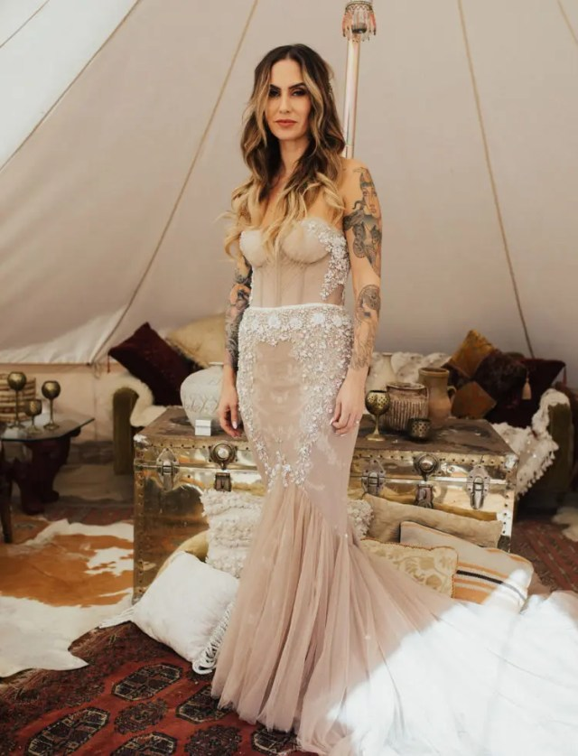 3bd6c6351e5 a strapless blush heavily embellished mermaid wedding dress with a train
