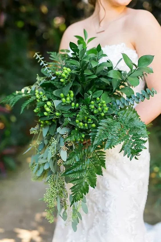 a cascading wedding bouquet with leaf fern, seeded eucalyptus, baby blue eucalyptus and hpericum berries