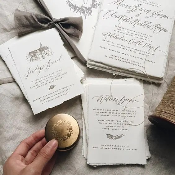 hand painted calligraphy wedding invitation suite is a trendy idea for a modern wedding