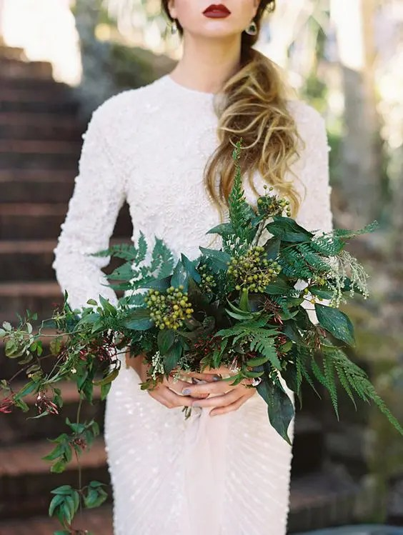 such a bold wedding bouquet with ferns and berries will contrast your white wedding gown