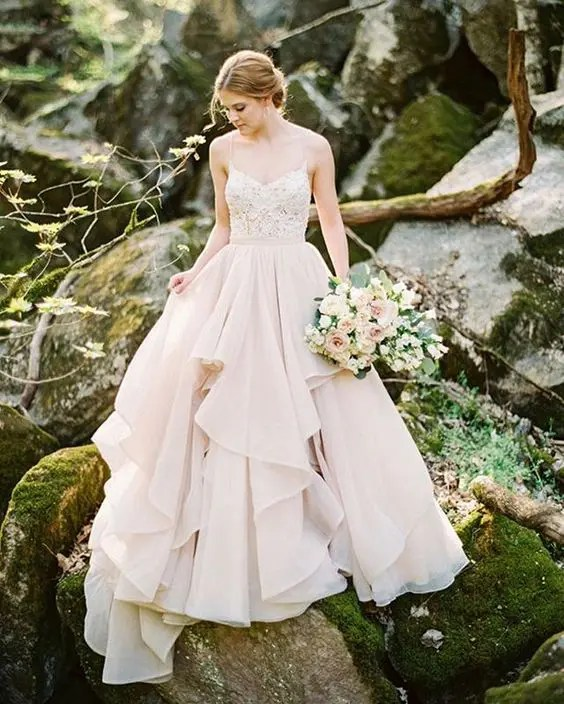 a glam bridal separate with an embellished spaghetti strap top and a blush ruffled maxi full skirt