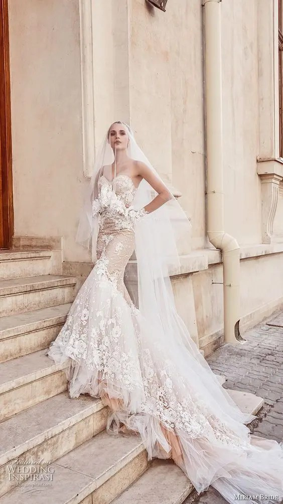 6918a47c198 a blush strapless mermaid wedding gown with white lace and a train for a  statement