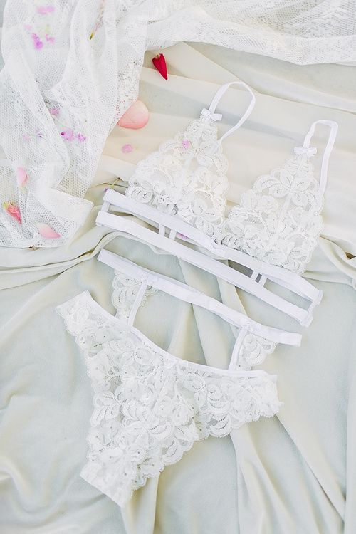 a lace bridal lingerie set with a strappy bra, panties and a stocking belt
