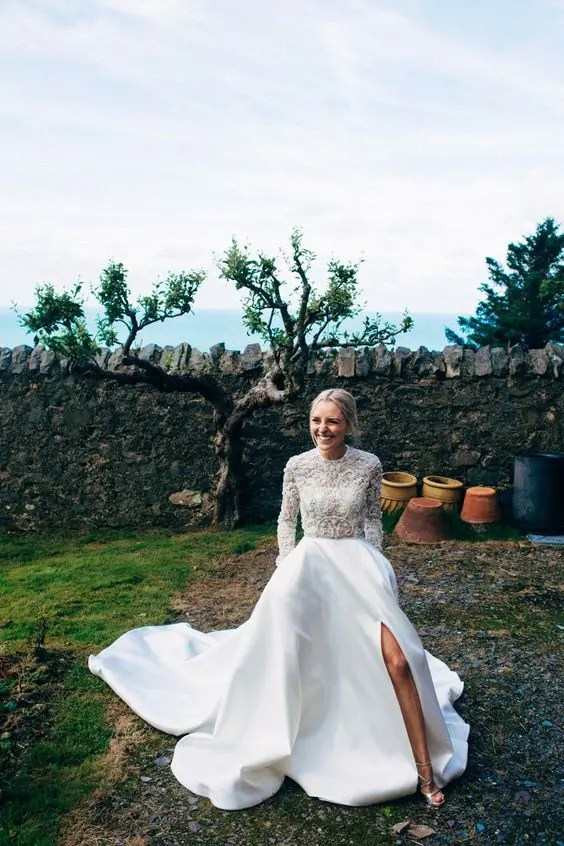 a sheer lace embellished wedding top with long sleeves and a plain full skirt with a side slit