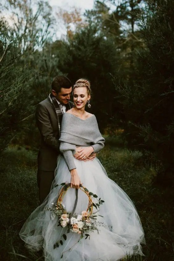 a winter bridal look with a white tulle skirt and a grey off the shoulder sweater
