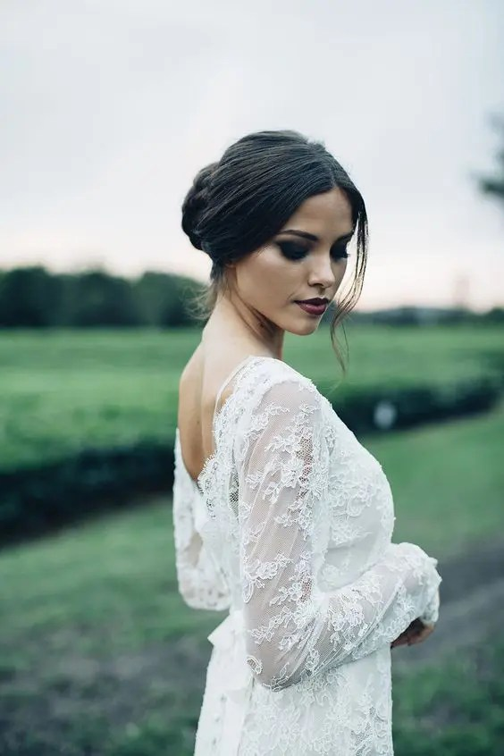 a dark berry lip and black smokeys are right what you need for a dramatic bridal look