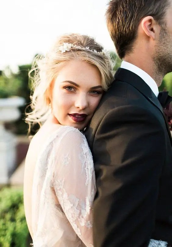 a dark berry lip is a bold statement for a blonde bride with blue eyes - such an edgy solution