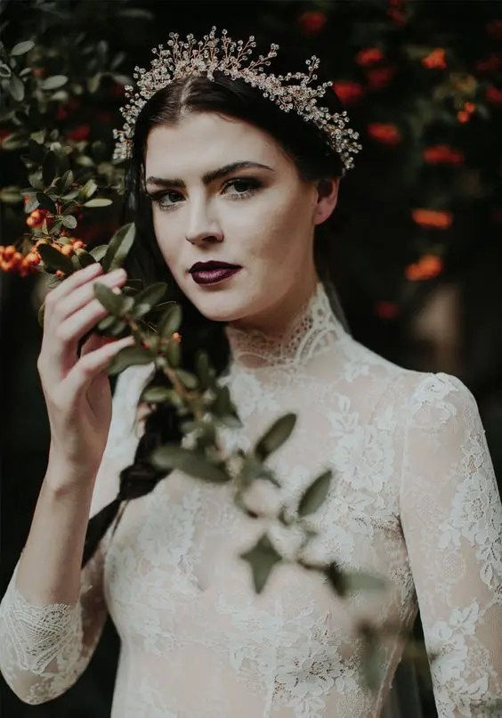 a haunted bridal look with an aubergine lip and no other accents is a bit spooky yet very chic