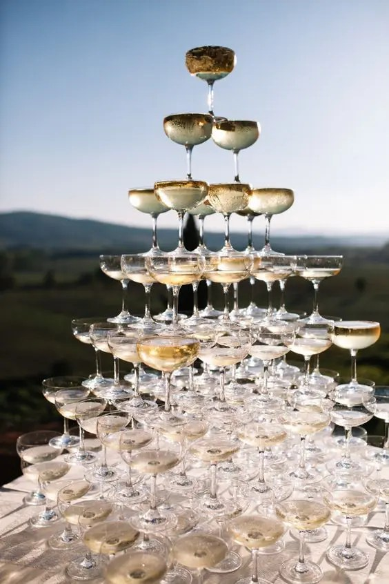 a large champagne tower is sure to impress every guest, and sun beams will play on the glass edges