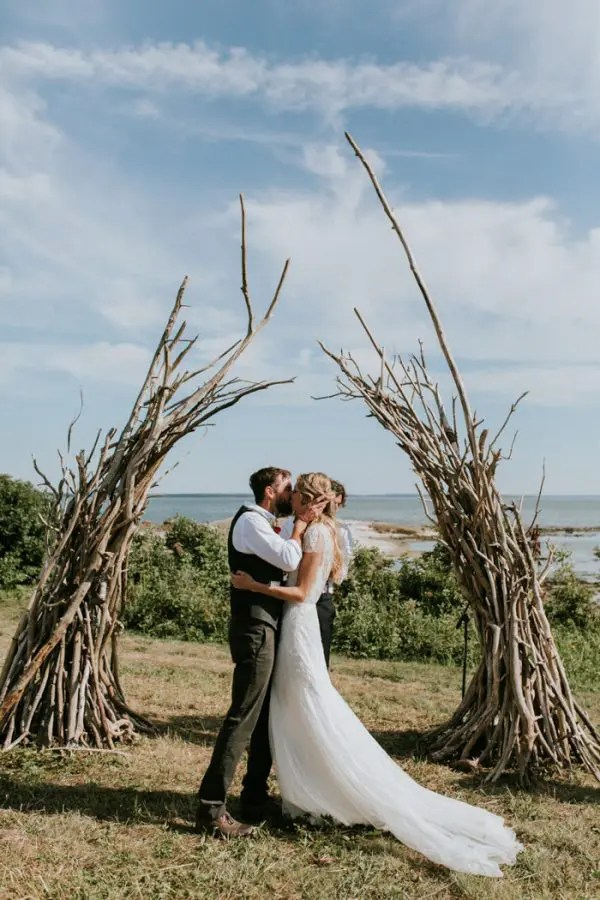 a driftwood and branches wedding altar for a wild and woodland feel can be a nice idea for many locations