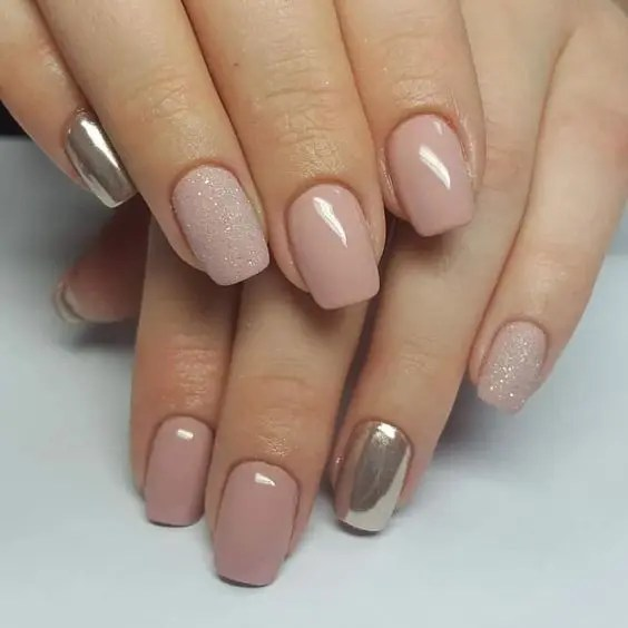 a nude manicure with a touch of glitter and silver nails for those who still insist on classics