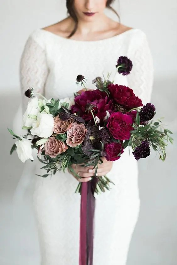 a super bold ombre wedding bouquet with white, dusty pink, deep purple and crimson blooms for a winter bride