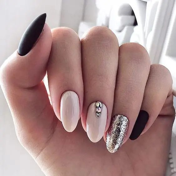 glossy white, matte black nails, an accent with rhinestones and silver glitter for a holiday wedding