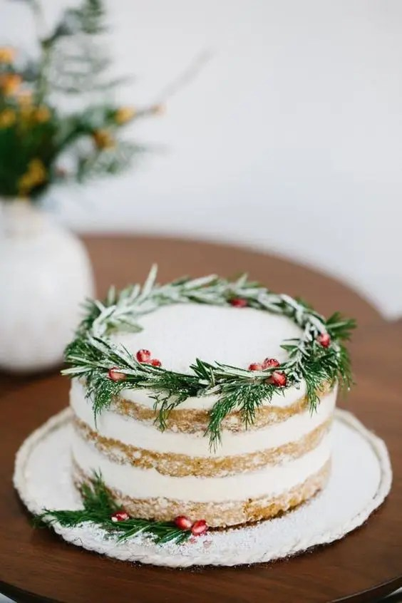 serve several naked wedding cakes like this one and top them with pomegranate seeds and fresh greenery