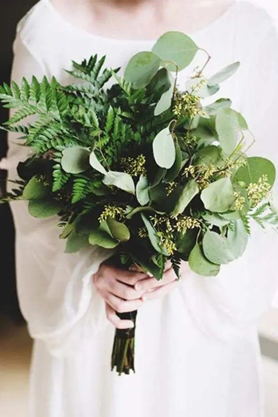a simple eucalyptus and fern wedding bouquet is a great solution for a woodland or holiday bride