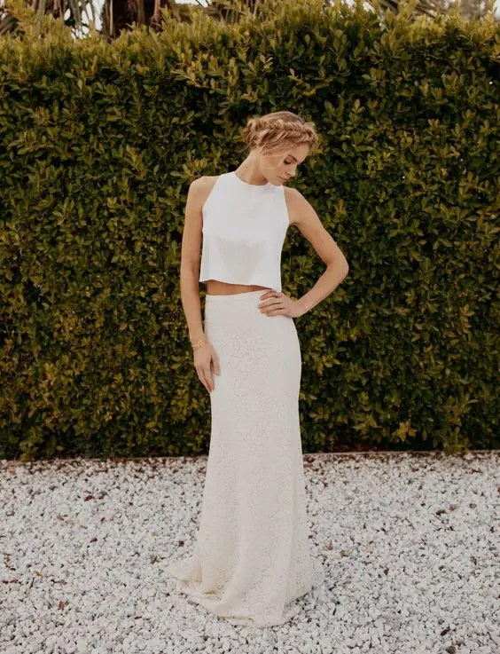 a modern bridal separate with a lace pencil skirt and a plain high neck top with no sleeves