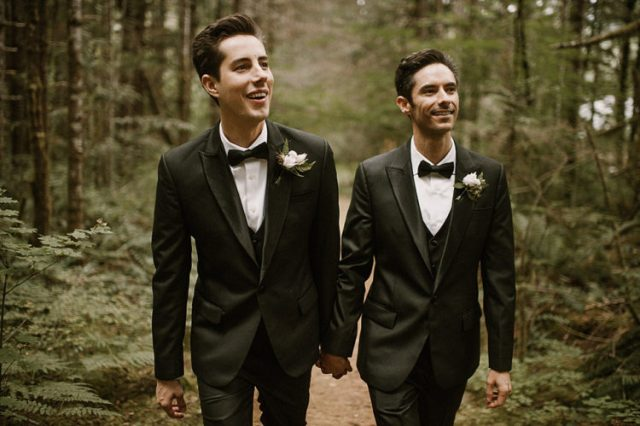 The couple was wearing the same black three-piece suits with bow ties