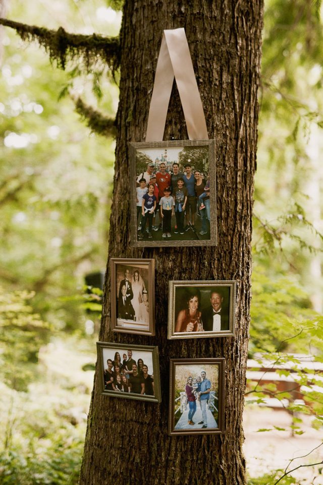 The couple hung some family and friends pics on the trees