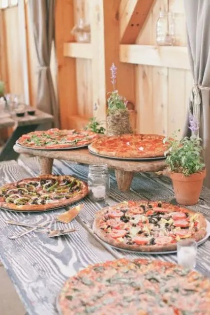 a simple rustic pizza bar with various pizzas will delight many guests who love such food