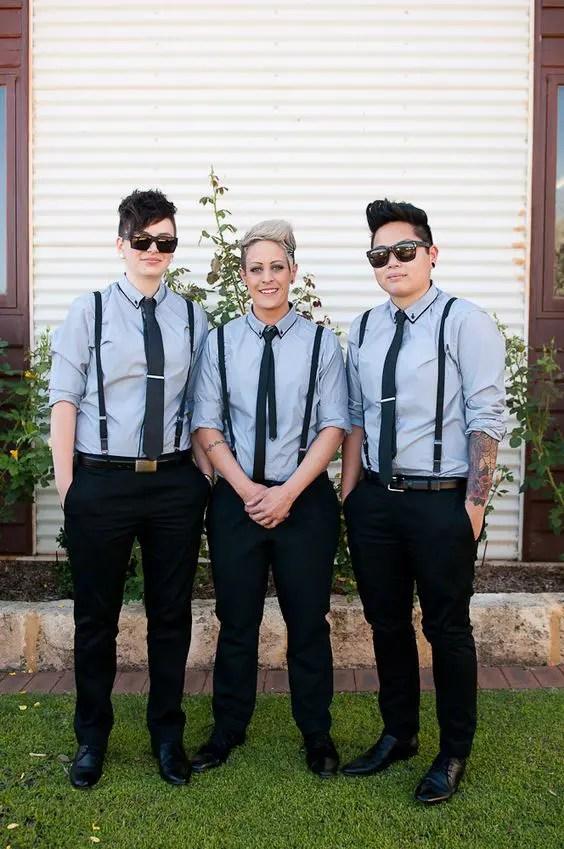 groomsladies wearing black pants, grey shirts, black suspenders and ties look cool and relaxed