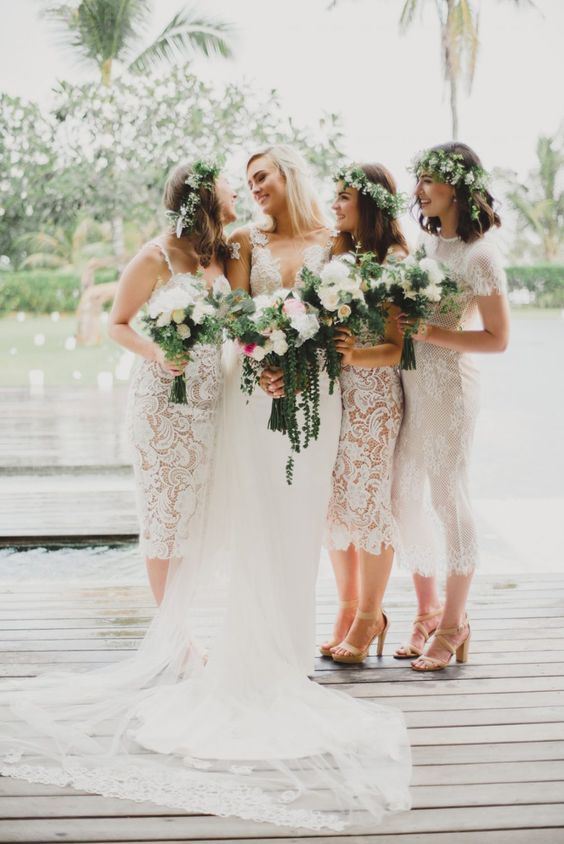 mismatching white lace midi bridesmaid dresses with various necklines for a tropical wedding