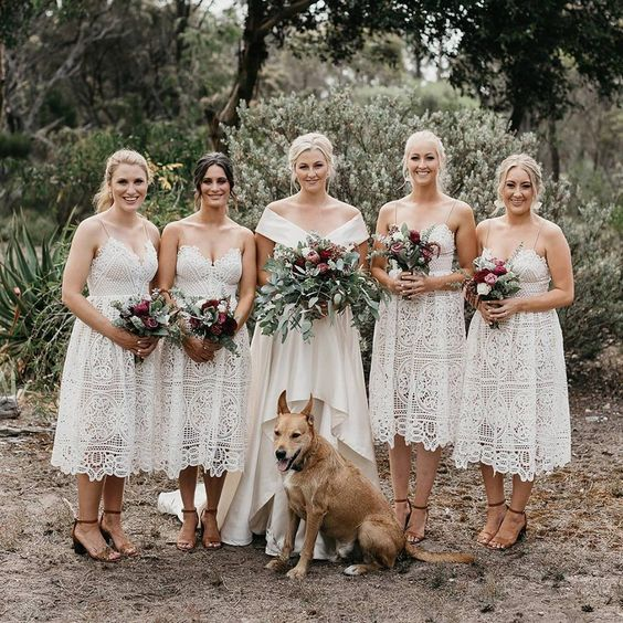 312afd3fcb4918 white lace midi bridesmaid dresses with spaghetti straps are comfy to wear  and give a boho