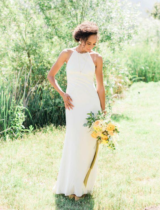 a minimalist halter neckline sheath wedding dress plus matching statement earrings