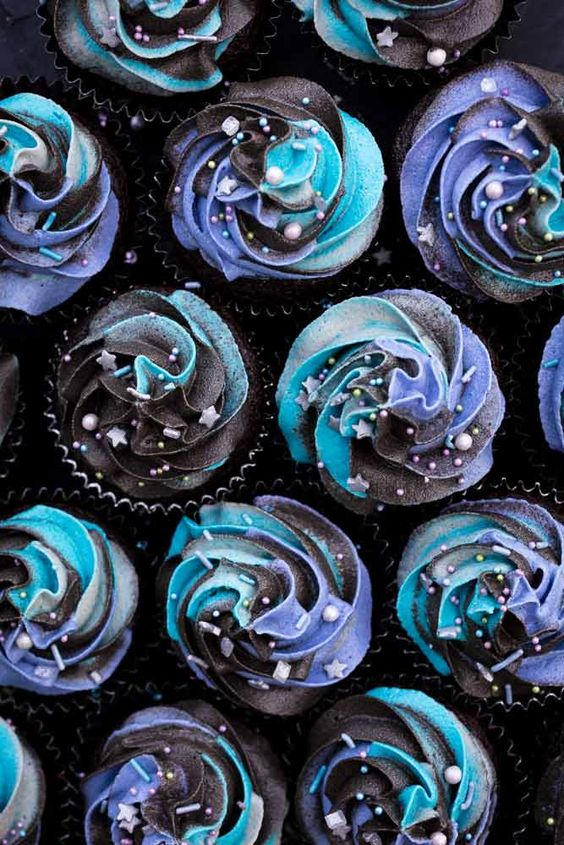 vegan galaxy cupcakes with a hidden vegan Milky Way inside and topped with cosmic swirls look wow