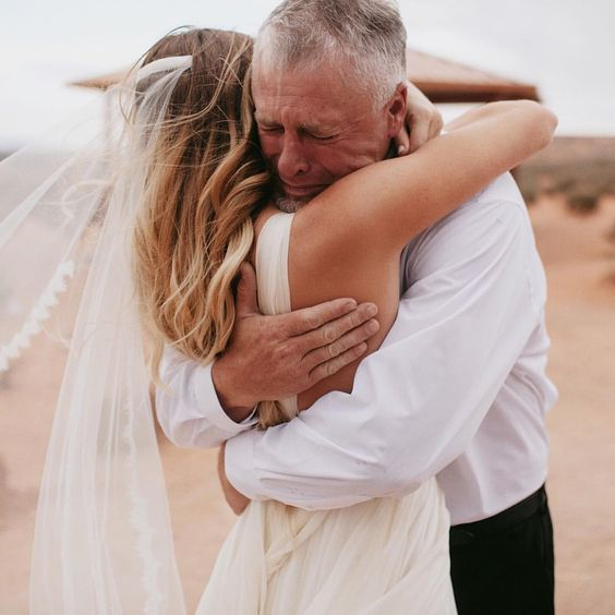 a father blessing his daughter bride after the ceremony is a timeless pic idea, who needs usual portraits together