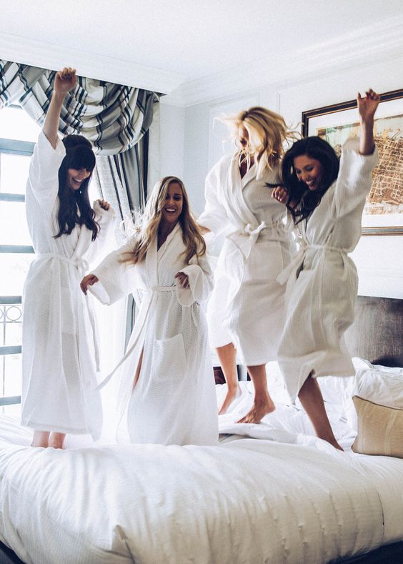 all the gals wearing comfy robes in the morning of the wedding day, before getting ready for the ceremony