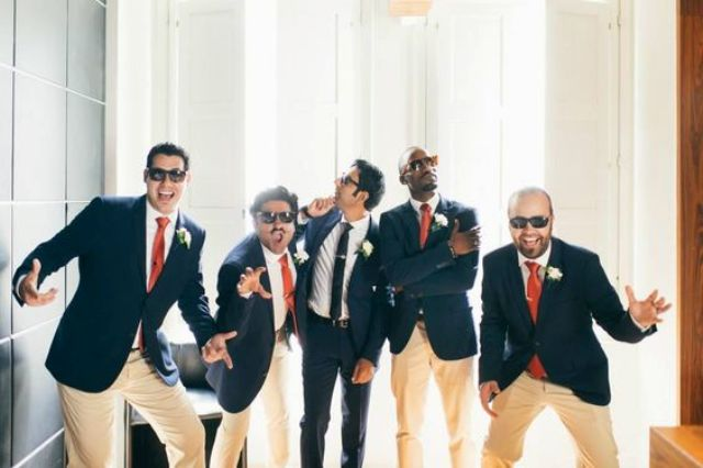 groomsmen having fun before the cermeony with the groom is a very cute and fun wedding pic idea