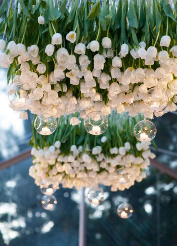 a fantastic white tulip chandelier with hanging candle holders just scream spring