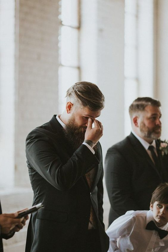 the groom crying while his bride is going down the aisle is a very touching moment of the ceremony