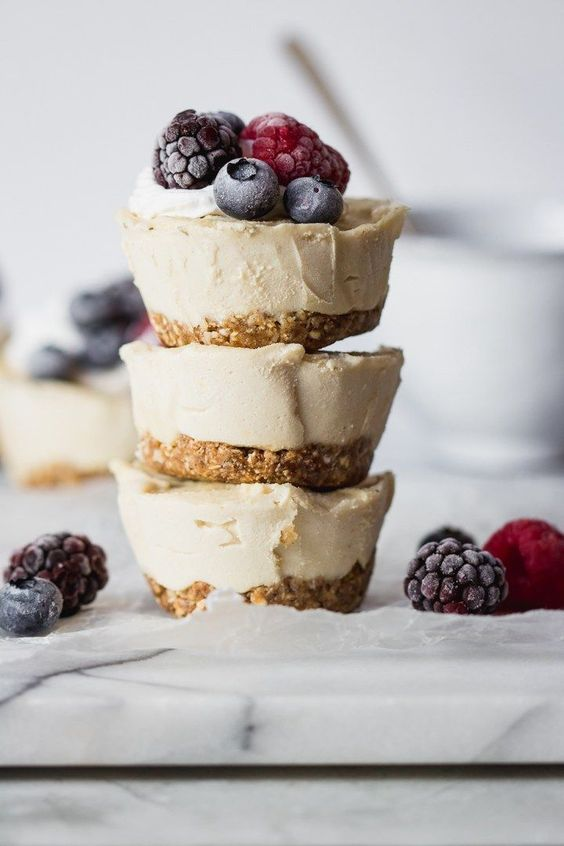 gluten-free and vegan mini cheesecakes with perfectly sweet lemon flavor and topped with fresh juicy berries