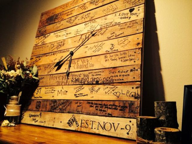 a pallet wedding guest book turned into a clock is a cool idea to reread all the wishes