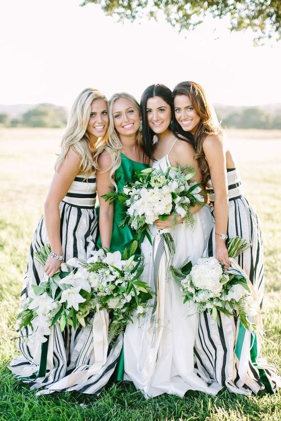 straped maxi gowns in black and white and an emerald one shoulder maxi dress for the maid of honor