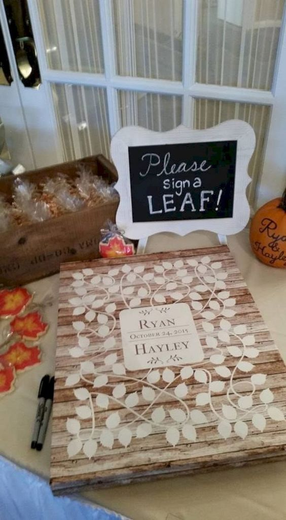 a pallet sign with leaves that are to be signed using a marker is a classic rustic idea