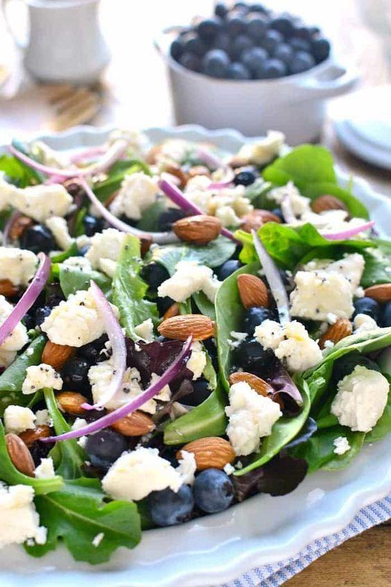 tasty spring salad of blueberries, feta cheese, almonds and with lemon poppyseed vinaigrette