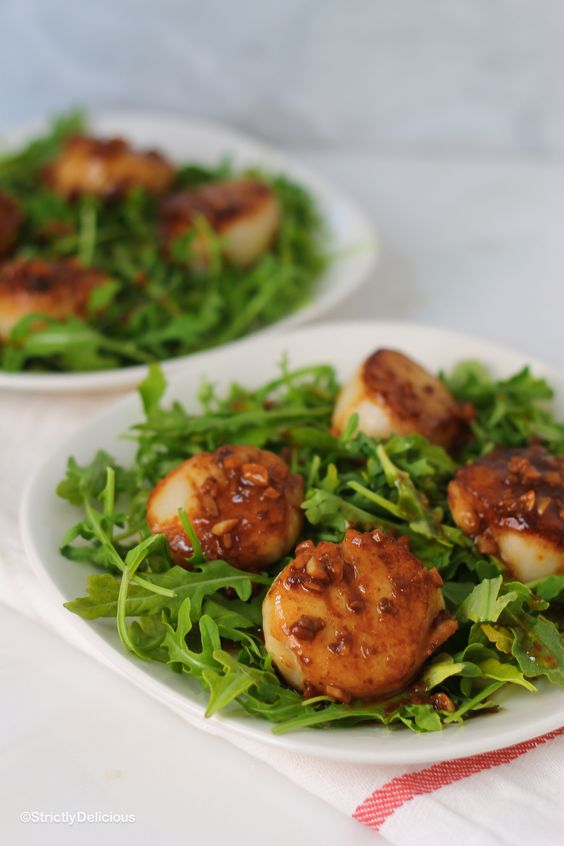 sea scallops over arugula with white wine garlic sauce is a fresh and not too hearty main course