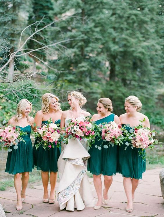 same emerald knee dresses and a one shoulder one for the maid of honor is a cool fall choice