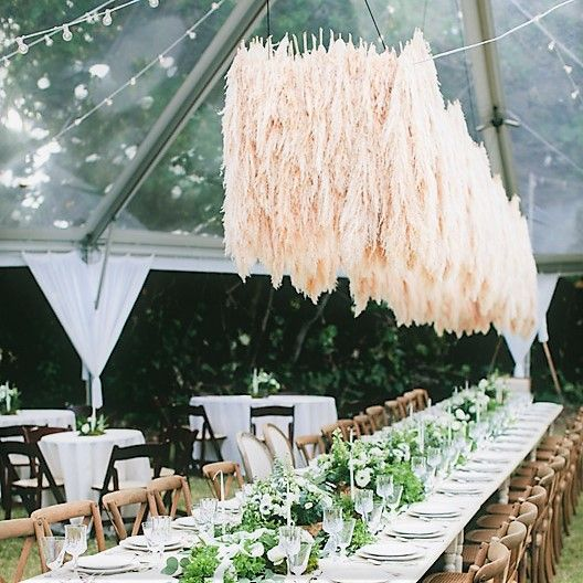 a floating pampas grass wedding installation over your reception tables will make them super trendy